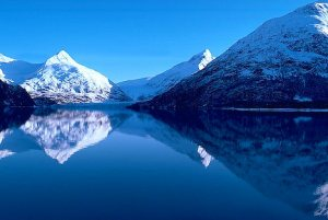 Alaska. Chugach Mts. Portage Glacier and Portage Lake, mountain reflection in water.