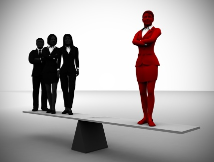 Balancing a team leader with a great team. A team of three executives stands on a balance where the counterweight is a great team leader.
